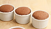 Chocolate souffles in ramekins