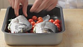 Oven-roasted seabream being prepared (German Voice Over)