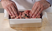 Preparing Mediterranean meatloaf (German Voice Over)