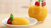 Passion fruit sorbet garnished with berries