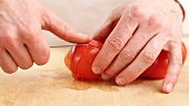 A tomato being peeled