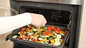 Vegetables being roasted in the oven