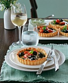 Olive and tomato tartlets with basil