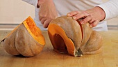 A raw pumpkin being prepared (German Voice Over)