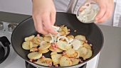 Fried potatoes being made (German Voice Over)