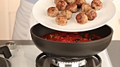 Meatballs with tomato sauce being made (German Voice Over)