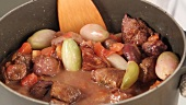 Stifado (Greek meat stew) being made (German Voice Over)
