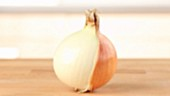 A part-peeled onion