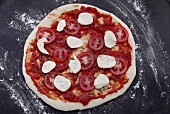 Pizza Margherita being topped (stop motion)