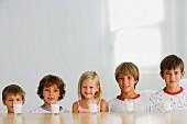 Five children and five glasses of milk