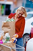 Young woman with bags of shopping
