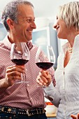 Older couple drinking wine