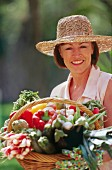 Woman with basket full of vegetables