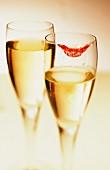 Champagne glass with lipstick on rim