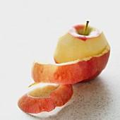 A half-peeled apple