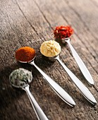Herbs and spices: oregano, paprika, curry powder and saffron