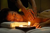Woman having massage by candlelight