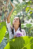Young woman in summer rain