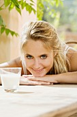 Young blond woman with a glass of milk