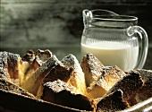 Bread Pudding with Powdered Sugar; Cream
