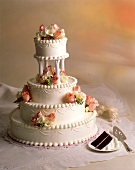 Four Tiered Chocolate Wedding Cake with Roses; Slice