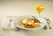 Eggs Benedict and a Glass of Orange Juice