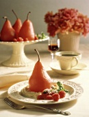 Whole Poached Pear with Raspberry Garnish