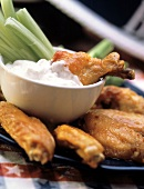 Buffalo Chicken Wings Dipped in Blue Cheese; Celery