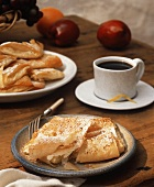 A dessert setting of Baklava and coffee.