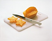 Carambola on a Cutting Board Being Sliced