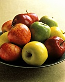 Assorted Types of Apples in a Bowl