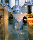 Chilled Vodka in Stem Glass; Bottles