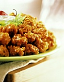 Buffalo Style Chicken Wings on Platter; Sauce