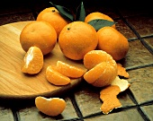 Honey Tangerines on Tile; One Peeled