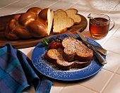 French Toast with Powdered Sugar and Berrie; Egg Bread and Pitcher of Maple Syrup