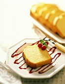 Slice of Pound Cake on Raspberry Sauce