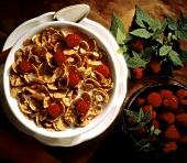 Cereal Flakes in Bowl with Raspberries