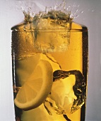 Ice Cube Splashing into a Glass of Iced Tea