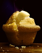A Corn Muffin with Melting Butter; Steam