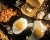 Fried Eggs on Saw Blade; Bacon and Toast
