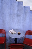 Table at Cafe with Espresso and Newspaper