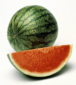 A Whole Seedless Watermelon and a Wedge