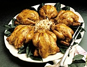 Six Roasted Cornish Game Hens on Platter; Rice