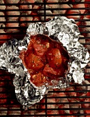 Tomatoes and Garlic in Foil on the Grill