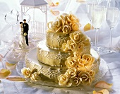 Three Tier Wedding Cake; Bride and Groom; Champagne