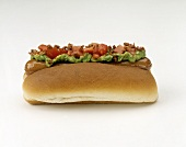 Hot Dog on Roll with Guacamole; Bacon and Tomatoes