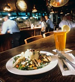 Chicken and Couscous; Beer Served in a Pub
