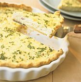 Lifting a Slice of Quiche with Chives