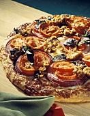 Sliced Tomato and Sausage Pizza; Basil