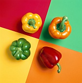 Four Assorted Bell Peppers on Colored Squares